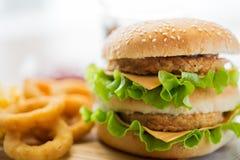 Close up of hamburger or cheeseburger on table Royalty Free Stock Images