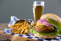 Close up of hamburger served with french fries and beer Stock Photography
