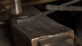 Close up. Hammer and Metal. Craftsman Blacksmith working on his workshop.