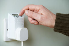 Close Up Of Hand Adjusting Timer Switch In Plug Socket Royalty Free Stock Images