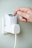 Close Up Of Hand Adjusting Timer Switch In Plug Socket Stock Image