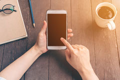 Close up hand asia woman using phone in coffee shop with vintage Stock Photo