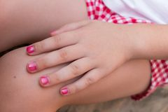 Baby girl with pink nail polish royalty free stock photography