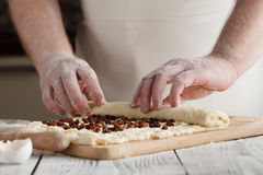 Close-up the hand of a baker kneading and shaping dough Royalty Free Stock Photos