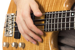 Close-up of a hand on a bass guitar Stock Images