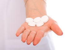 Close-up on the hand big white pill Royalty Free Stock Images