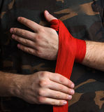 Close-up of hand boxer pulls wrist wraps before the fight Royalty Free Stock Photo