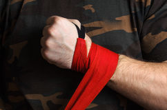 Close-up of hand boxer pulls wrist wraps before the fight Stock Photos