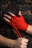 Close-up of hand boxer pulls wrist wraps before the fight Royalty Free Stock Photography