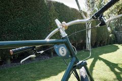 Close-up of a hand built path racer bicycle seen in a private garden. Royalty Free Stock Images