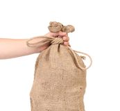 Close up of Hand with burlap sack Royalty Free Stock Photo
