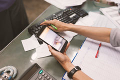 Close up of hand of business man working document and using mobile. Smart phone in office Stock Photos