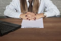 Close-up on the hand of a business woman, empty contract to sign. Portrait of a business person stock image