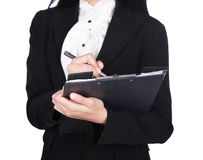 Close up hand of business woman writing on a clipboard isolated. On a white background Royalty Free Stock Photos