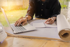 Close up hand of business young man holding pen and using laptop Stock Photo