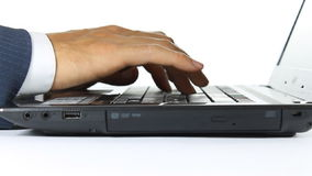Close-Up Hand of Businessman Typing on Laptop Computer. Businessman is working and typing on laptop. Close-up view and focus at hand of businessman in dolly stock video