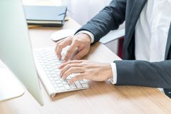 Close-up hand of businessman using computer Stock Photography