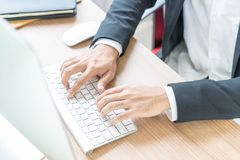 Close-up hand of businessman using computer. Selective Focus Point Stock Photo