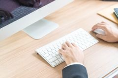 Close-up hand of businessman using computer. Selective Focus Point Royalty Free Stock Photo