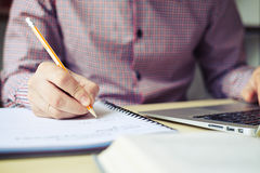 Close up of hand businessman who taking notes Stock Photography