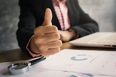 Close up hand of businesswoman thumb up with confidence. On office background Stock Photo