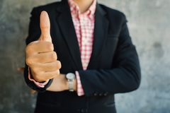 Close up of hand businesswoman thumbs up with confidence. On loft background Stock Photos