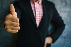 Close up of hand businesswoman thumbs up with confidence. On loft background Royalty Free Stock Images