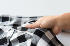 Close up of hand with checkered clothing item Royalty Free Stock Photos