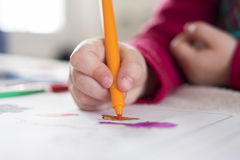 Close-up of hand child drawing with pencil at home Royalty Free Stock Photos