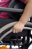 Close-up on hand of child in wheelchair. Close-up on hand of handicapped child in wheelchair royalty free stock images