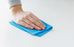 Close up of hand cleaning table surface with cloth Stock Image