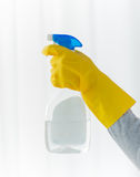 Close up of hand with cleanser spraying Stock Image