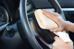 Close up hand cleansing car dashboard Stock Images
