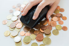 Close up of hand with computer mouse on money Royalty Free Stock Image