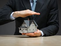 Close up of hand covering little house Stock Images