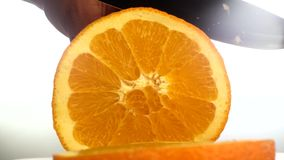 Close-up of hand cut orange stock video footage