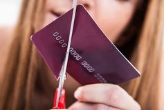 Close-up of hand cutting credit card Stock Image