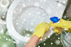Close up of hand with detergent cleaning toilet Royalty Free Stock Images