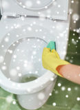Close up of hand with detergent cleaning toilet Royalty Free Stock Image