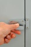 Close up hand on door lock Stock Photos