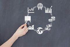 Close-up of hand drawing business icons on board Royalty Free Stock Photography
