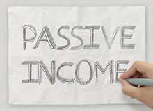 Close up of hand drawing passive income Royalty Free Stock Image
