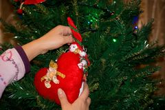 Close Up of a Hand Dressing The Christmas Tree With Homemade Dec Royalty Free Stock Photos