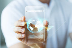 Close up of hand with earth globe on smartphone Royalty Free Stock Image