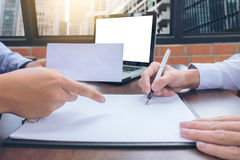 Close up of the hand employer focus the employee to write a lett Stock Image