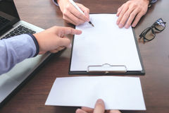 Close up of the hand employer focus the employee to write a lett Royalty Free Stock Image