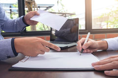 Close up of the hand employer focus the employee to write a letter of resignation and filing final remuneration, resign concept stock images
