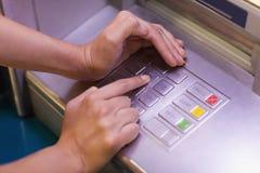 Close up of hand entering pin Stock Photos