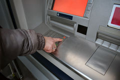 Close up of hand entering pin at an ATM. Female arms, ATM - entering pin.Woman using banking machine Royalty Free Stock Photo