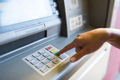 Close up of hand entering pin code at atm machine Stock Photo